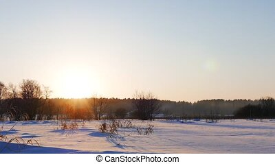 Winter field at sunset. Russia