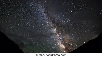 Milky Way over the mountains. Clouds and moonrise. Plateau...