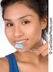 Healthy teeth - Latina teenager girl brushes her teeth