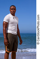 Man on beach - Portrait of young African-American man on...