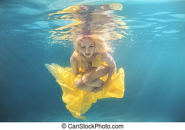 The pool woman swims underwater. - In the pool underwater...