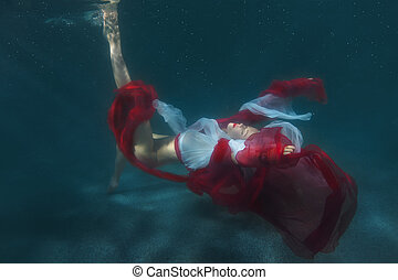 Dancing woman underwater. - Dancing woman underwater, she is...