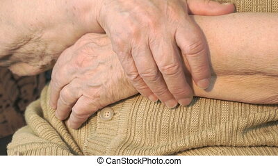 Elderly woman hand with wrinkled skin. Close up