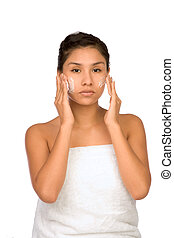 Applying Moisturizer - Hispanic girl applying facial...