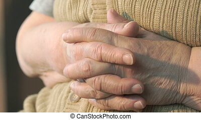 Old wrinkled hands of woman. Close up