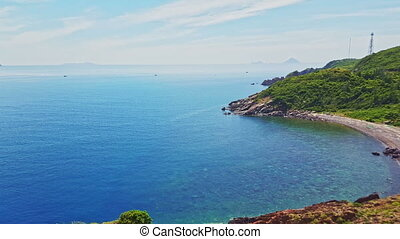Hilly Coastline and Boundless Azure Ocean against Blue Sky -...