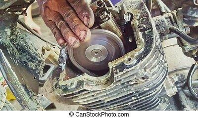 Closeup Man Hand Checks Scooter Engine Operation - closeup...