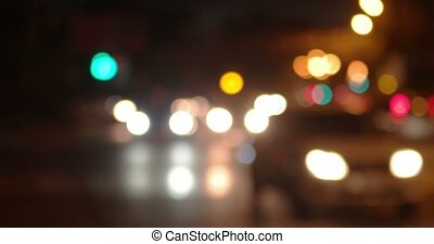 Blurry night shot of city traffic. Defocused cars of...