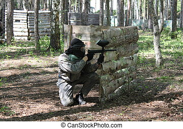 Paintball. Shooting competition of weapons with paint balls....