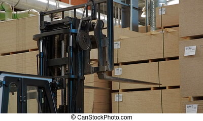 Loader working at warehouse in lumber factory - Camera...