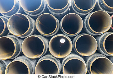 oil and gas - Concrete rounded pipes stacking on deck for...
