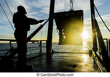 Oil and gas - Silhouette of worker recovering robotics...