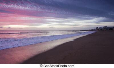 Magically pink sunset over the sea. Quarteira Algarve