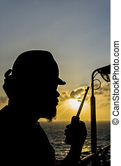Oil and gas - Silhouete people of offshore crew holding...