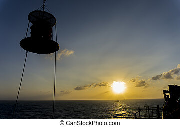 Oil and gas - Silhouete people.A group of offshore crew...
