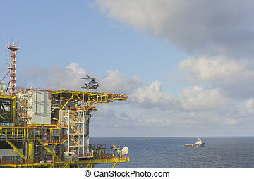 Oil and gas - Helicopter landing on offshore platform,...