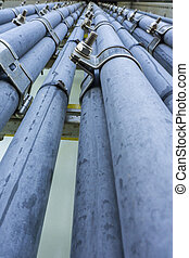 Oil and gas - Low angle view of high voltage electrical...
