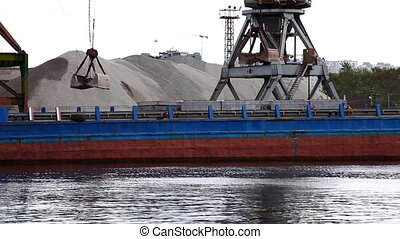 shipboard crane loaded sand