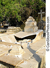 Desecrated grave - Destroyed and ruined grave at Christian...