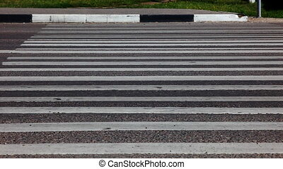 Zebra crossing road with moving cars
