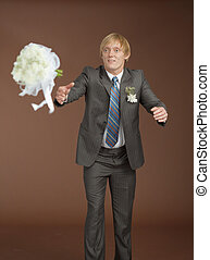 Groom catches a flying bouquet - The groom catches a flying...
