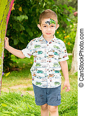 Cute little child boy with akvagrim in park on nature at...