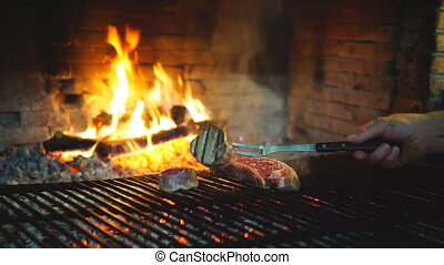 Sirloin steak on grill, cooking - Man hand preparing sirloin...