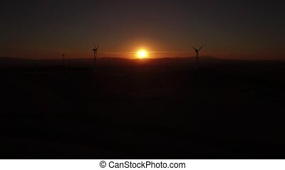 Sunset over windmills - Flying towards windmills at sunset...