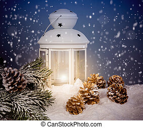Christmas decoration with white lantern,gold cones and...