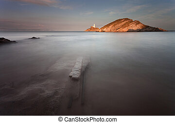 Mumbles lighthouse Swansea - Submerged rail tracks near the...