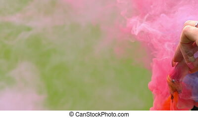 color pink smoke on a grass background