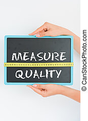 Quality measurement concept on blackboard