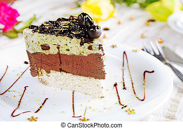 Cake - A slice of chocolate cake on a white plate.