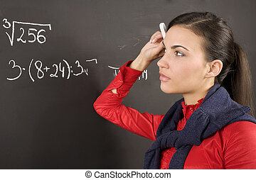 girl at blackboard - student dirl at a blackboard during a...