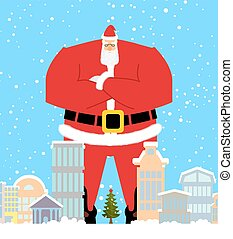 Santa Claus in city. Christmas in town. Snow and buildings....