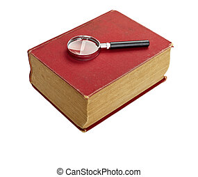 close up of an old book and loupe on white background with...