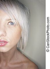 A stock photograph of blonde woman with blue eyes.