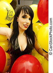 a cute woman surrounded by colorful balloons - A stock...