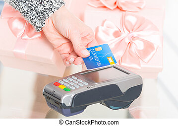 Paying with contactless credit or debit card - Hand holding...