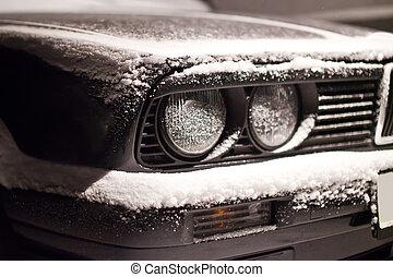 Restored front part of black old car.