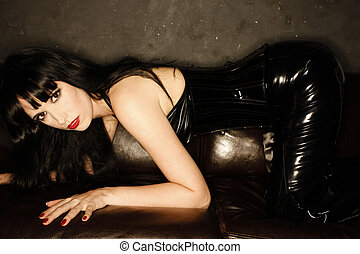 A stock photograph of mistress on a couch...