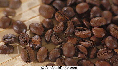 Close up background of roasted brown coffee beans in 4K.