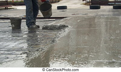 Leveling Wet Concrete Surface with a Metal Screed Board -...