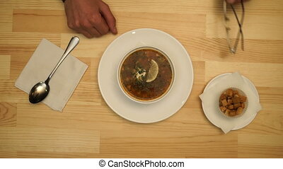 Man eats soup in a cafe. top view