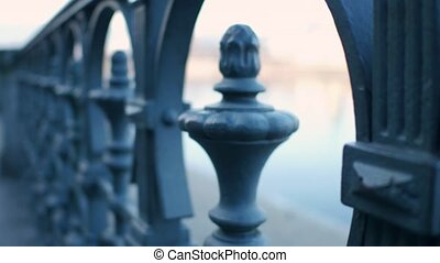 Old river embankment railing. 4K steadicam close-up shot -...