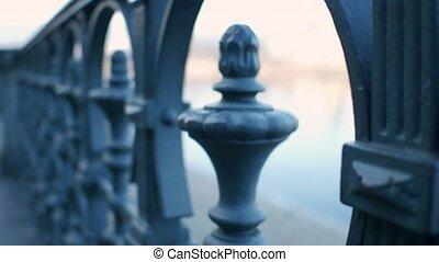 Old river embankment railing. 4K steadicam close-up shot -...