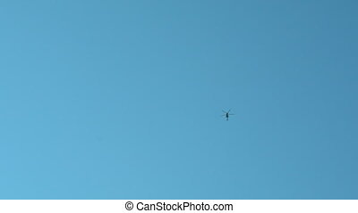 a helicopter hovers in the sky