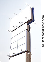 Blank billboards against a bright blue sky