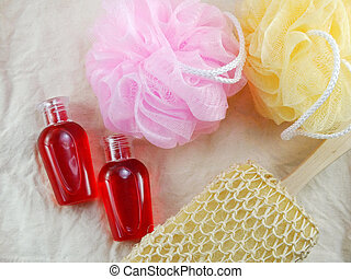 shower gel with bath puff and loofah spa kit top view
