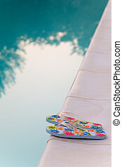 flip-flops near the swimming-pool